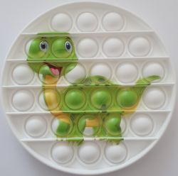 Pop it GMEX - kulatý dinosaurus